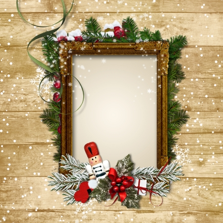Christmas frame with the decor and the Nutcracker on a wooden photo