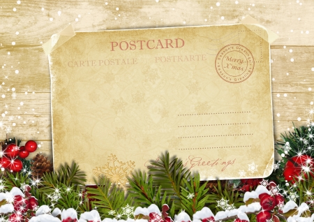 Christmas card on a wooden background with decorations  Standard-Bild