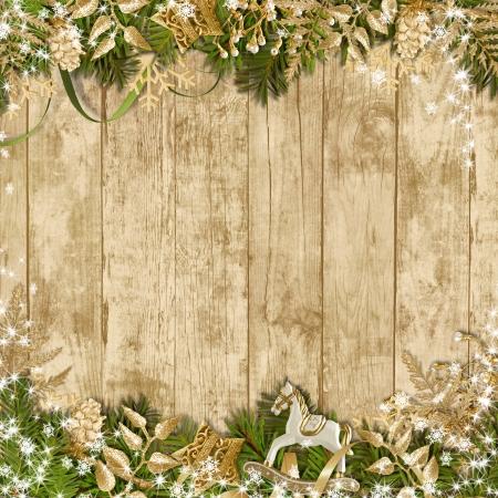 Magic Christmas garland on a wooden background Magic Christmas garland on a wooden background  Standard-Bild
