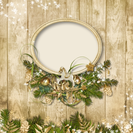 Christmas frame with miraculous garland on a wooden background  Christmas frame with miraculous garland on a wooden background  photo