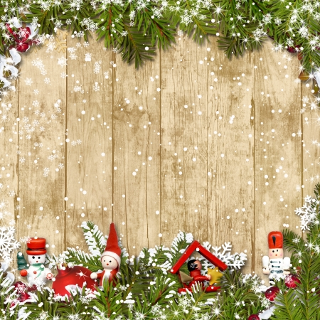Christmas background with a border of fir branches and decoratio  Christmas background with a border of fir branches decorations  Stock Photo