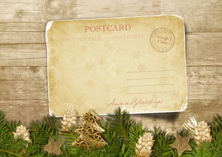 Christmas vintage postcard with fir-tree with cones over wood  photo