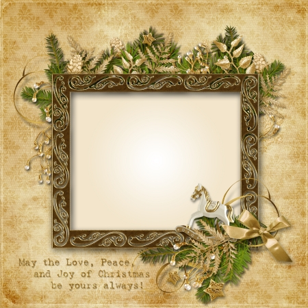 Christmas card with golden garland, frame and warm wishes  photo
