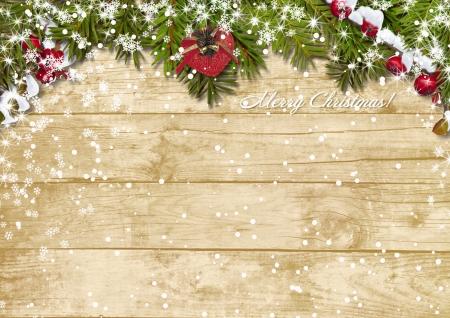 snowfall: Christmas fir tree with snowfall on a wooden board  Stock Photo