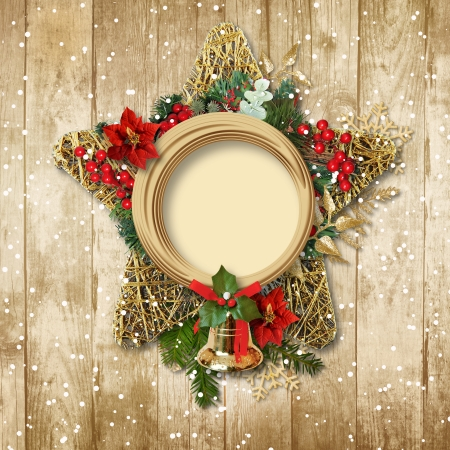 Christmas decoration with poinsettia bell on a wooden board  photo