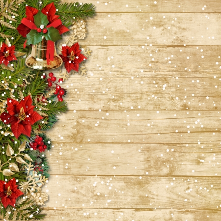 Christmas beautiful garland with poinsettia bell on wooden board  photo