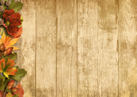 Vintage wooden background with autumn decorations photo