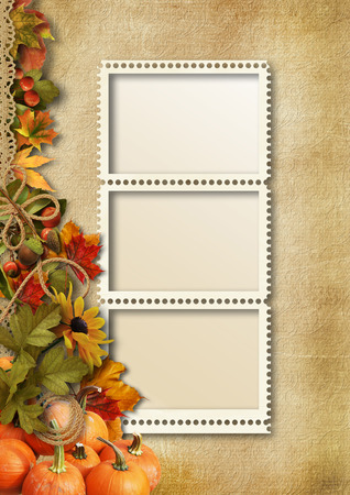 Autumn leaves,pumpkins and photo-frame on a vintage background photo