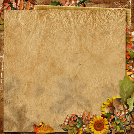 Vintage crumpled paper with autumn decorations photo