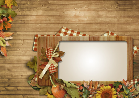 Autumn leaves,pumpkins,frame on a wooden background photo