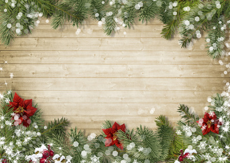 postcards: Christmas border with poinsettia on old wood background Stock Photo