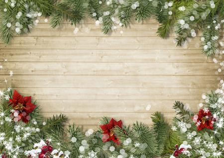 Frontera de la Navidad con el poinsettia sobre fondo de madera vieja