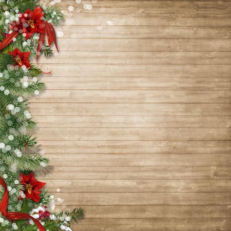 fondo legno: Priorit� bassa di legno di Natale con poinsettia e firtree Archivio Fotografico