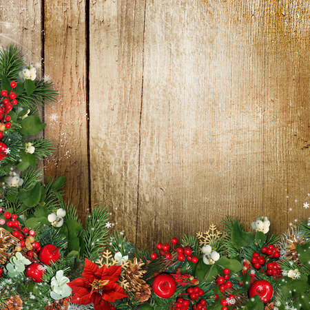 Christmas wreath on grunge wood texture with holly,firtree,v?scum photo