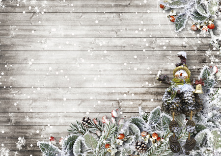 new year tree: Christmas card on a wooden board with beautiful snowy leaves