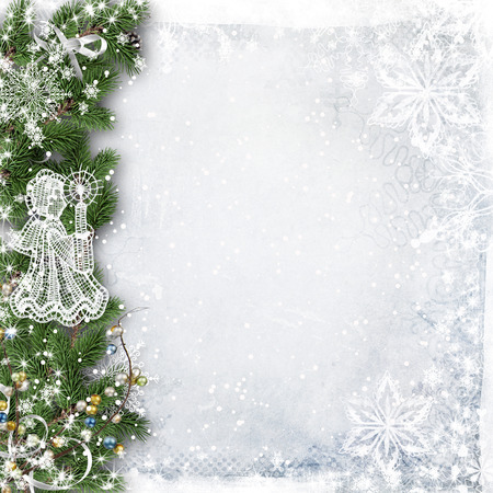 lace up: Christmas background with tree branches, snow and angel Stock Photo
