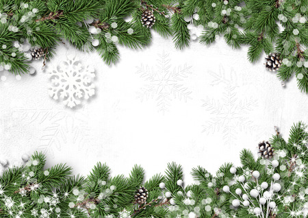 Fir tree border with holly isolated on white background