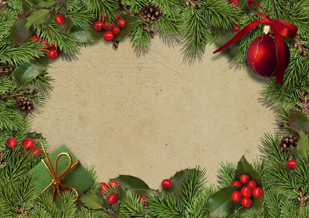 evergreen: Christmas vintage background with fir branches and holly Stock Photo