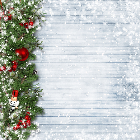 Christmas border with holly and nutcracker on vintage wood.