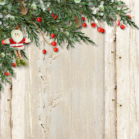 red berries: Christmas card with Santa and red berries on vintage wooden. Stock Photo