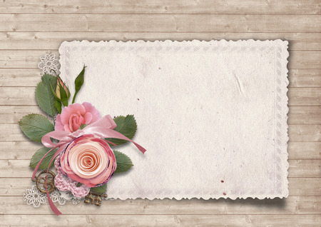 photoalbum: Old card on wooden background with roses