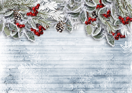 Christmas wooden background with snowy branch