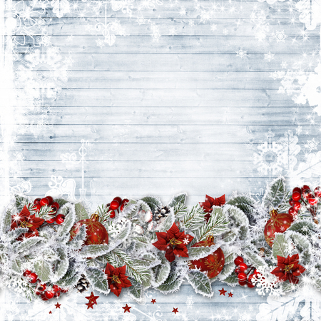 flower banner: Christmas background with a border fir branches, red berries and balls on wooden boards Stock Photo