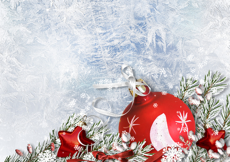 Christmas decoration. Red ball on frosty background with snow branches Stock Photo
