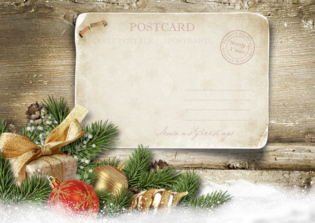 postcard background: Christmas background with vintage postcard, ball, fir on wood