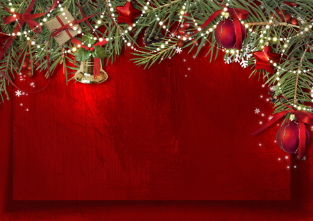 Christmas decoration border with bell, firtree and ball on red paper Stock Photo