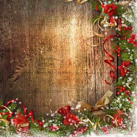 Christmas border with bell, holly, poinsettia on wooden board