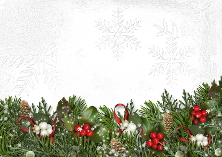 Christmas border with branches, mistletoe and holly on white