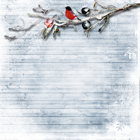 vintage postcard: winter frosty branches with berries and snowflakes on a wooden snowy background Stock Photo