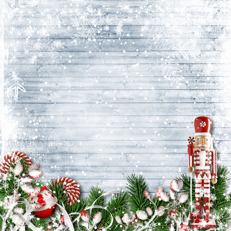 Christmas background with a nutcracker and candy cane. with firtree