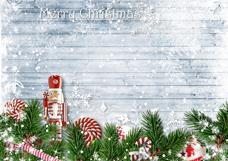 Christmas decor with a nutcracker and candy cane. with firtree Reklamní fotografie - 89353737