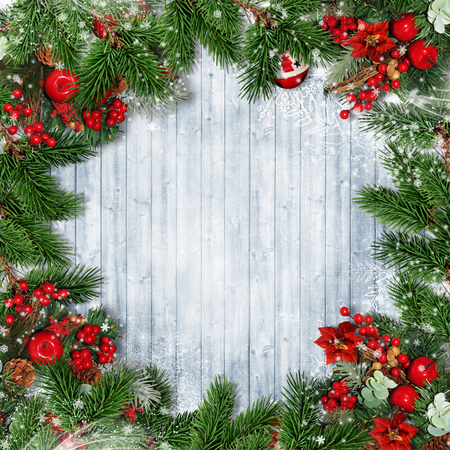 Christmas border with firtree, holly and Christmas wreath on wood