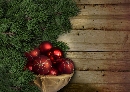 Christmas fir tree with red balls on vintage boards