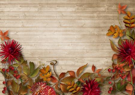 Autumn border on vintage wooden background