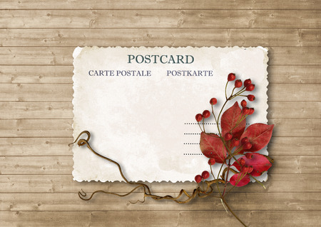 Autumn background with vintage card and bouquet Фото со стока