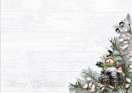 Christmas greeting card with snow-covered branches