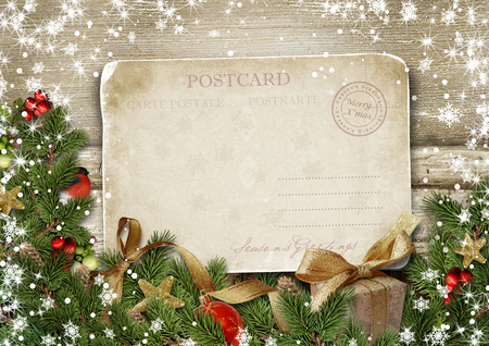 Merry Christmas greeting card with decorations and vintage postcard