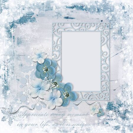 Winter background with photo frame and charming flowers Фото со стока