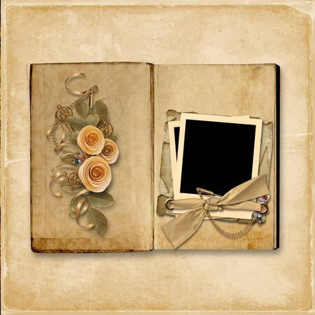 Grunge background with vintage album with roses Фото со стока