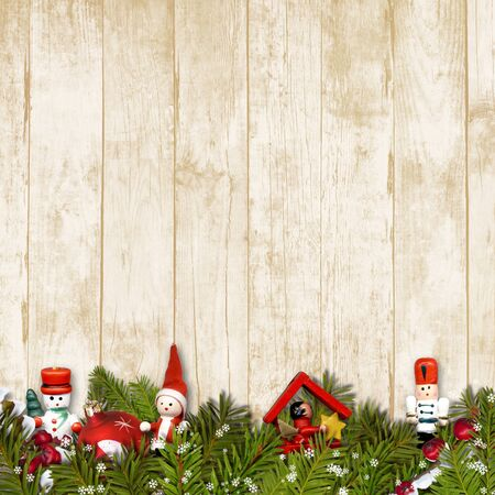 Border of Christmas toys on vintage wooden background. holiday background