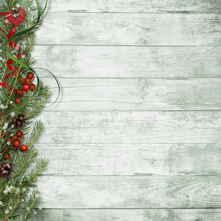 Christmas firtree with holly, snowflake on wooden board Фото со стока