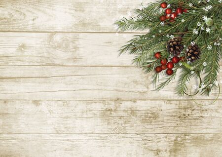 Christmas tree branch, decorations with holly on wooden board Фото со стока