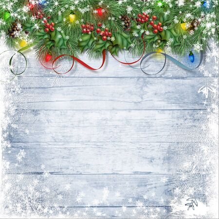 Festive garland with holly, lights and firtree on a snowy wooden Stock Photo