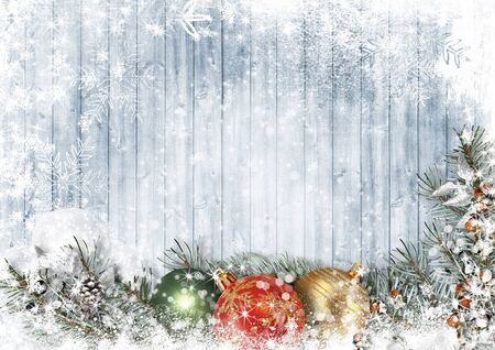 Christmas wood texture with garland with balls, snow and firtree Imagens
