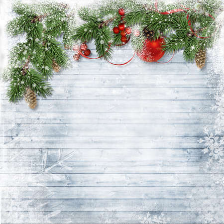 Christmas wooden background with snow fir tree and holly. View with copy space Stockfoto
