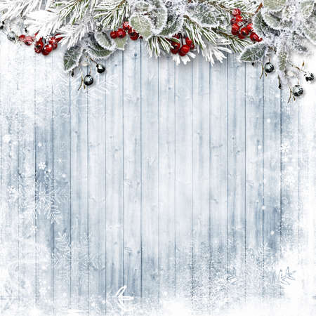 Christmas Holiday wood background with snow, holly and firtree. Copy space